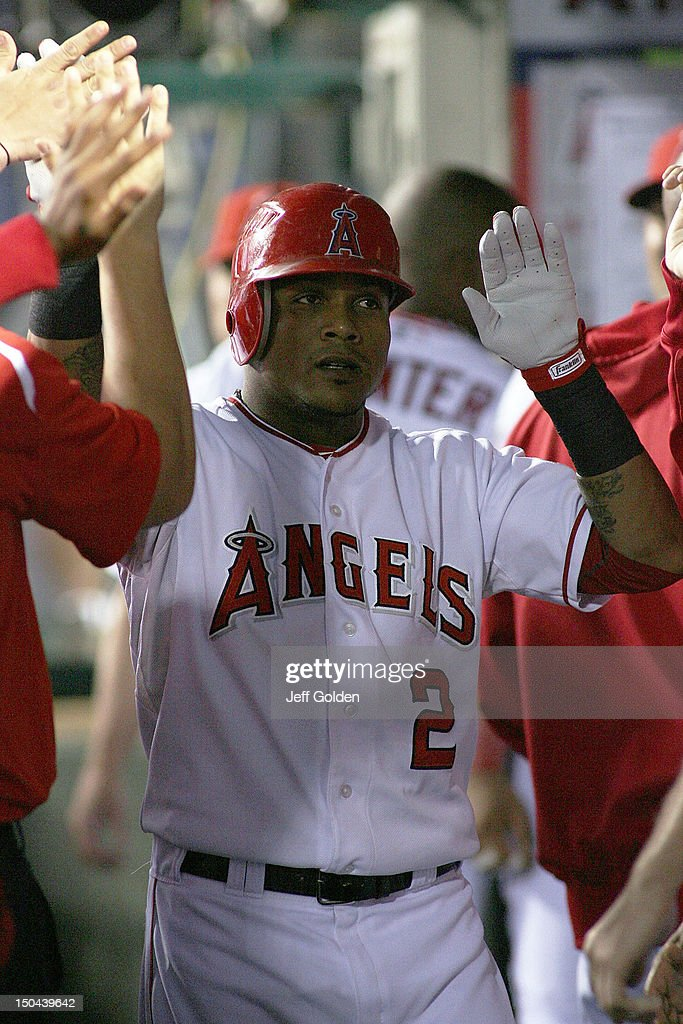 <a gi-track='captionPersonalityLinkClicked' href=/galleries/search?phrase=Erick+Aybar&family=editorial&specificpeople=551376 ng-click='$event.stopPropagation()'>Erick Aybar</a> #2 of the Los Angeles Angels of Anaheim high-fives teammates in the dugout after hitting a solo home run to right center field against the Tampa Bay Rays to lead off in the third inning at Angel Stadium of Anaheim on August 17, 2012 in Anaheim, California.
