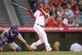 Erick Aybar of the Los Angeles Angels of Anaheim hits a 3 RBI triple in the second inning against the Kansas City Royals on June 11 2011 at Angel...