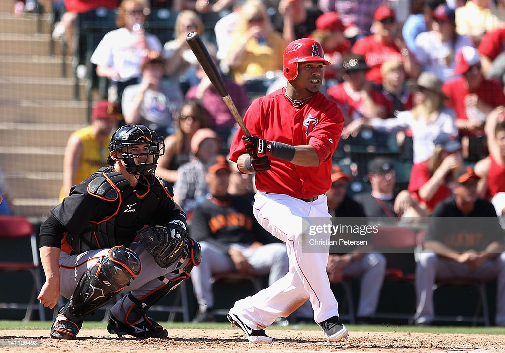 <a gi-track='captionPersonalityLinkClicked' href=/galleries/search?phrase=Erick+Aybar&family=editorial&specificpeople=551376 ng-click='$event.stopPropagation()'>Erick Aybar</a> #2 of the Los Angeles Angels of Anaheim hits a single against the San Francisco Giants during the third inning of the spring training game at Tempe Diablo Stadium on March 10, 2012 in Tempe, Arizona.