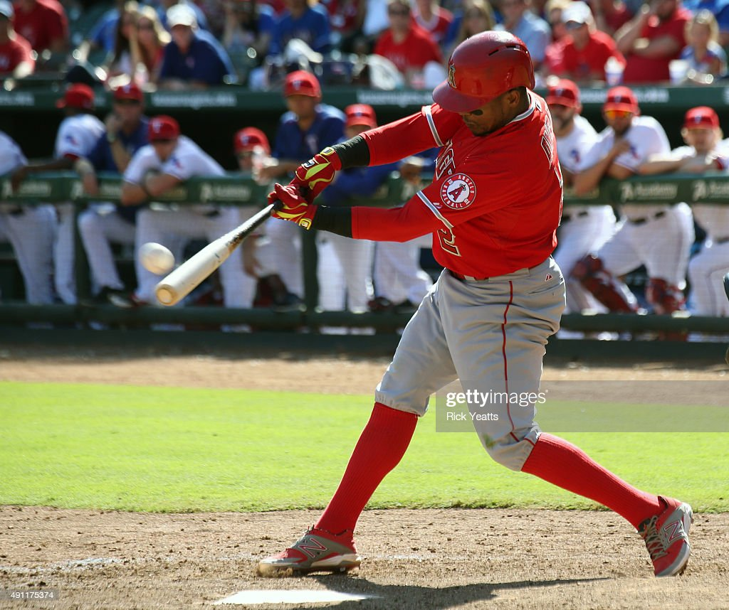 <a gi-track='captionPersonalityLinkClicked' href=/galleries/search?phrase=Erick+Aybar&family=editorial&specificpeople=551376 ng-click='$event.stopPropagation()'>Erick Aybar</a> #2 of the Los Angeles Angels of Anaheim hits a solo home run in the ninth inning against the Texas Rangers at Rangers Global Life Park in Arlington on October 3, 2015 in Arlington, Texas.