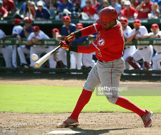 Erick Aybar of the Los Angeles Angels of Anaheim hits a solo home run in the ninth inning against the Texas Rangers at Rangers Global Life Park in...