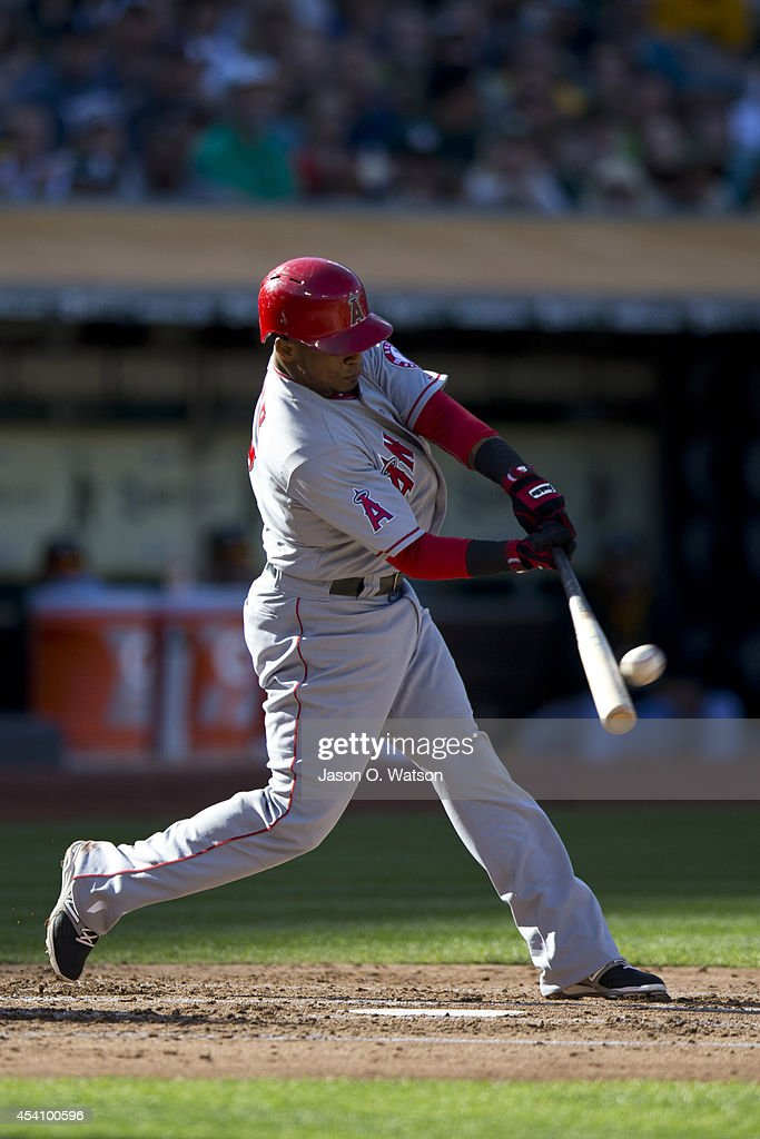 <a gi-track='captionPersonalityLinkClicked' href=/galleries/search?phrase=Erick+Aybar&family=editorial&specificpeople=551376 ng-click='$event.stopPropagation()'>Erick Aybar</a> #2 of the Los Angeles Angels of Anaheim hits a two run double against the Oakland Athletics during the second inning at O.co Coliseum on August 24, 2014 in Oakland, California.