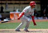 Erick Aybar of the Los Angeles Angels of Anaheim hits an RBI base hit scoring Mike Trout against the Oakland Athletics in the top of the six inning...