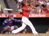 Erick Aybar of the Los Angeles Angels of Anaheim hits an RBI single in the fifth inning against the Texas Rangers at Angel Stadium of Anaheim on July...