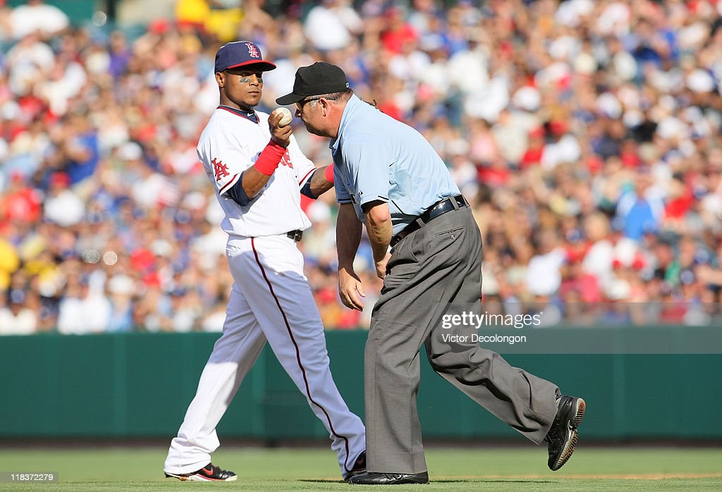 <a gi-track='captionPersonalityLinkClicked' href=/galleries/search?phrase=Erick+Aybar&family=editorial&specificpeople=551376 ng-click='$event.stopPropagation()'>Erick Aybar</a> #2 of the Los Angeles Angels of Anaheim looks at the ball during their MLB game at Angel Stadium against the Los Angeles Dodgers of Anaheim on July 3, 2011 in Anaheim, California. Loney was called safe at second for a double. The Angels defeated the Dodgers 3-1.