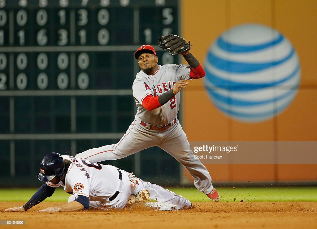 <a gi-track='captionPersonalityLinkClicked' href=/galleries/search?phrase=Erick+Aybar&family=editorial&specificpeople=551376 ng-click='$event.stopPropagation()'>Erick Aybar</a> #2 of the Los Angeles Angels of Anaheim makes a play on <a gi-track='captionPersonalityLinkClicked' href=/galleries/search?phrase=Jake+Marisnick&family=editorial&specificpeople=10507748 ng-click='$event.stopPropagation()'>Jake Marisnick</a> #6 of the Houston Astros at second base during the eighth inning of their game at Minute Maid Park on July 30, 2015 in Houston, Texas.