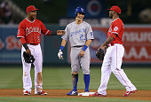 Erick Aybar of the Los Angeles Angels of Anaheim Norichika Aoki of the Kansas City Royals and Howie Kendrick of the Angels share a laugh during a...