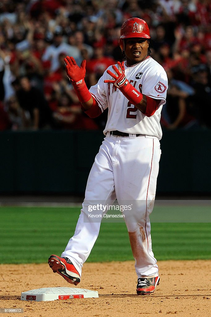 <a gi-track='captionPersonalityLinkClicked' href=/galleries/search?phrase=Erick+Aybar&family=editorial&specificpeople=551376 ng-click='$event.stopPropagation()'>Erick Aybar</a> #2 of the Los Angeles Angels of Anaheim reacts after hitting a double off Joba Chamberlain #62 (Not Shown) of the New York Yankees during the seventh inning in Game Three of the ALCS during the 2009 MLB Playoffs at Angel Stadium on October 19, 2009 in Anaheim, California.