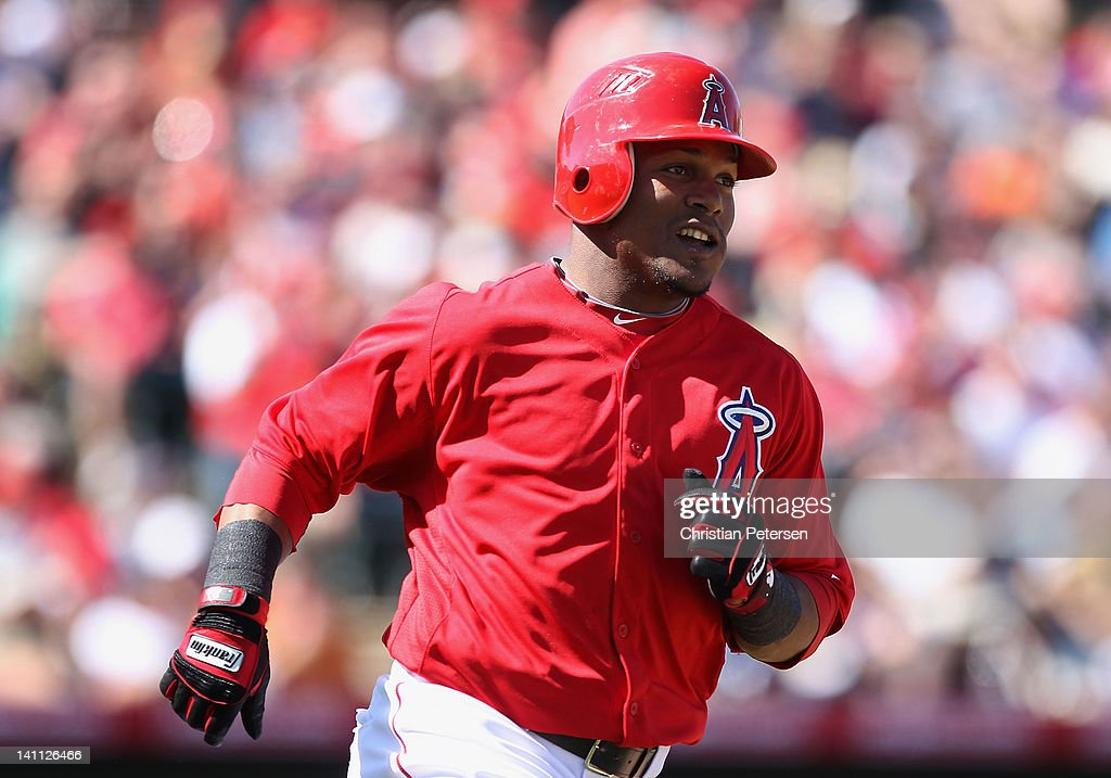 <a gi-track='captionPersonalityLinkClicked' href=/galleries/search?phrase=Erick+Aybar&family=editorial&specificpeople=551376 ng-click='$event.stopPropagation()'>Erick Aybar</a> #2 of the Los Angeles Angels of Anaheim runs to first base after hitting a single against the San Francisco Giants during the third inning of the spring training game at Tempe Diablo Stadium on March 10, 2012 in Tempe, Arizona.