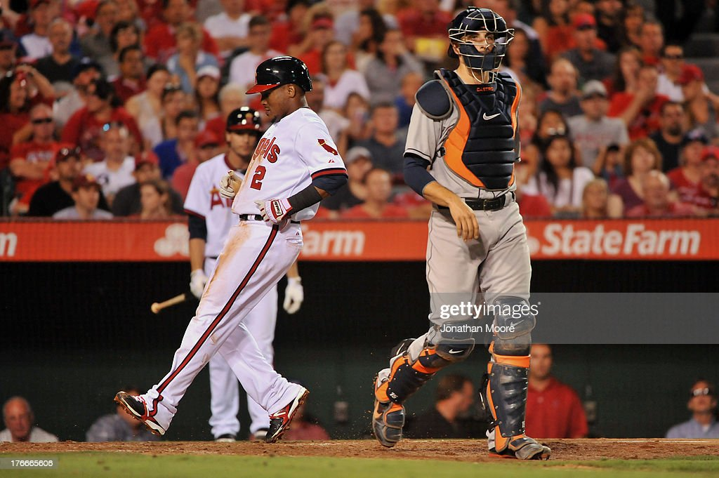 <a gi-track='captionPersonalityLinkClicked' href=/galleries/search?phrase=Erick+Aybar&family=editorial&specificpeople=551376 ng-click='$event.stopPropagation()'>Erick Aybar</a> #2 of the Los Angeles Angels of Anaheim scores past Jason Castro #15 of the Houston Astros after Hank Conger (not pictured) grounded out in the fifth inning during a game at Angel Stadium of Anaheim on August 16, 2013 in Anaheim, California.