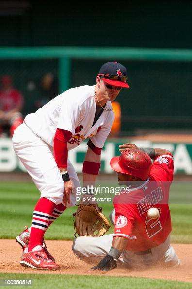 Erick Aybar of the Los Angeles Angels of Anaheim slides safely into second base against Brendan Ryan of the St Louis Cardinals at Busch Stadium on...