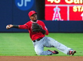 Erick Aybar of the Los Angeles Angels of Anaheim throws out a runner at second base during the 4th inning against the Atlanta Braves at Turner Field...