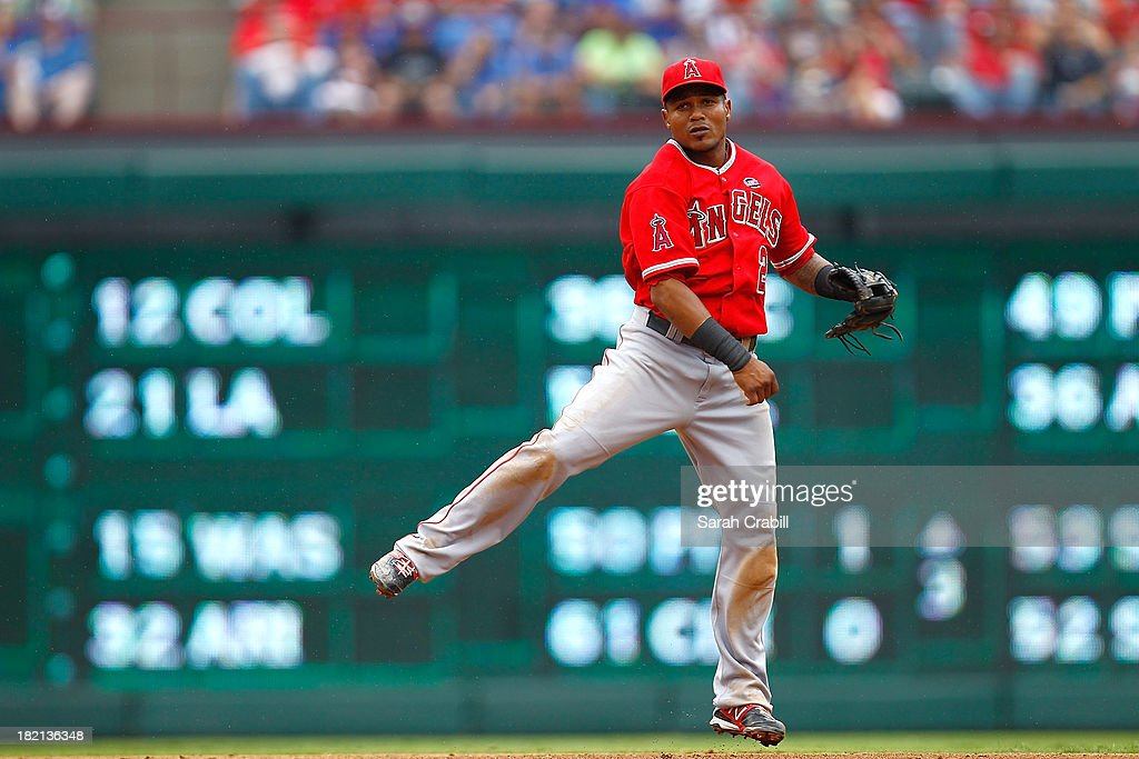 <a gi-track='captionPersonalityLinkClicked' href=/galleries/search?phrase=Erick+Aybar&family=editorial&specificpeople=551376 ng-click='$event.stopPropagation()'>Erick Aybar</a> #2 of the Los Angeles Angels of Anaheim throws to first base during a baseball game against the Texas Rangers at Rangers Ballpark in Arlington on September 28, 2013 in Arlington, Texas.