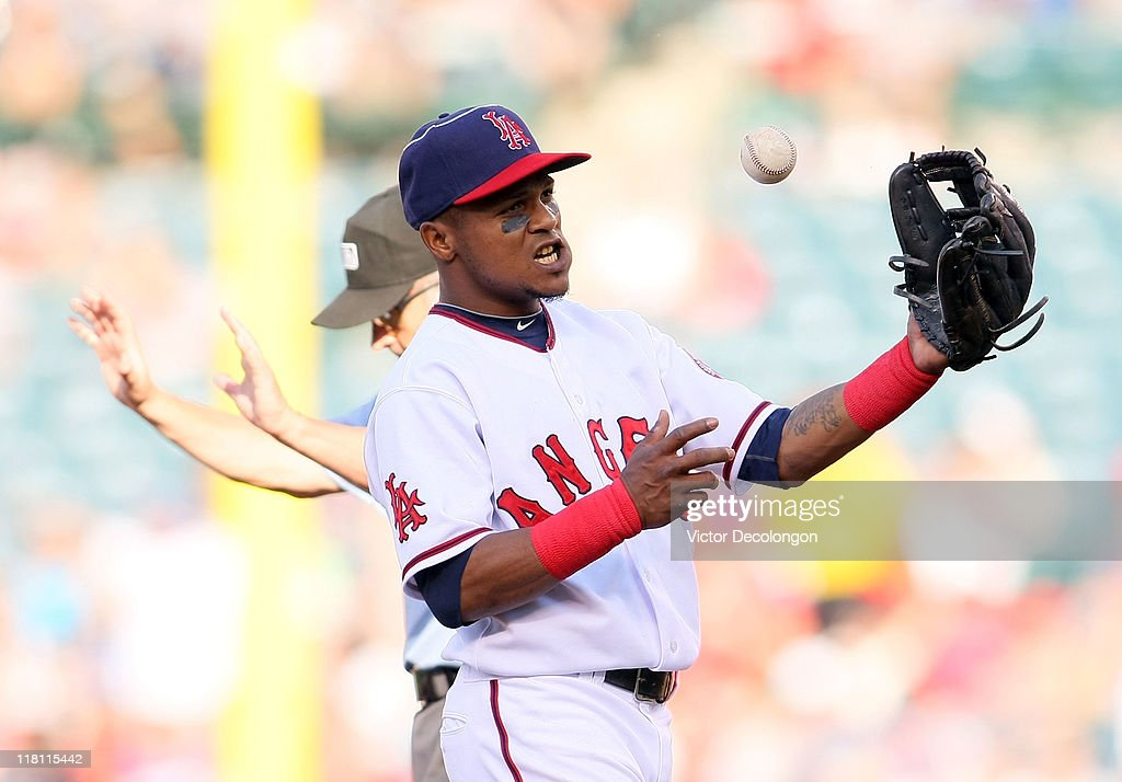 <a gi-track='captionPersonalityLinkClicked' href=/galleries/search?phrase=Erick+Aybar&family=editorial&specificpeople=551376 ng-click='$event.stopPropagation()'>Erick Aybar</a> #2 of the Los Angeles Angels of Anaheim tosses the ball in frustration after Tony Gwynn Jr. #10 of the Los Angeles Dodgers (not in photo) stole second base in the top of the third inning during their MLB game at Angel Stadium of Anaheim on July 3, 2011 in Anaheim, California. Loney was called safe at second for a double. The Angels defeated the Dodgers 3-1.