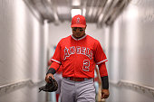 Erick Aybar of the Los Angeles Angels of Anaheim walks the tunnel out to the dugout before the game against the Texas Rangers at Globe Life Park in...