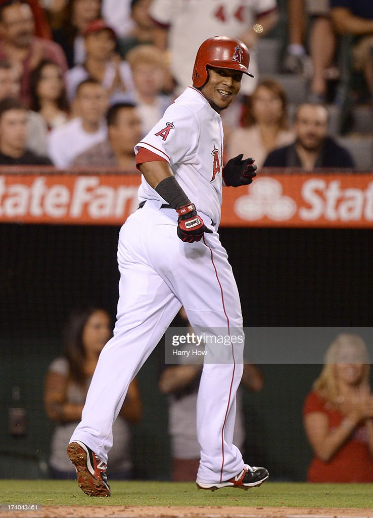 <a gi-track='captionPersonalityLinkClicked' href=/galleries/search?phrase=Erick+Aybar&family=editorial&specificpeople=551376 ng-click='$event.stopPropagation()'>Erick Aybar</a> #2 of the Los Angeles Angels reacts to his solo homerun for a 3-0 lead over the Oakland Athletics during the fifth inning at Angel Stadium of Anaheim on July 19, 2013 in Anaheim, California.