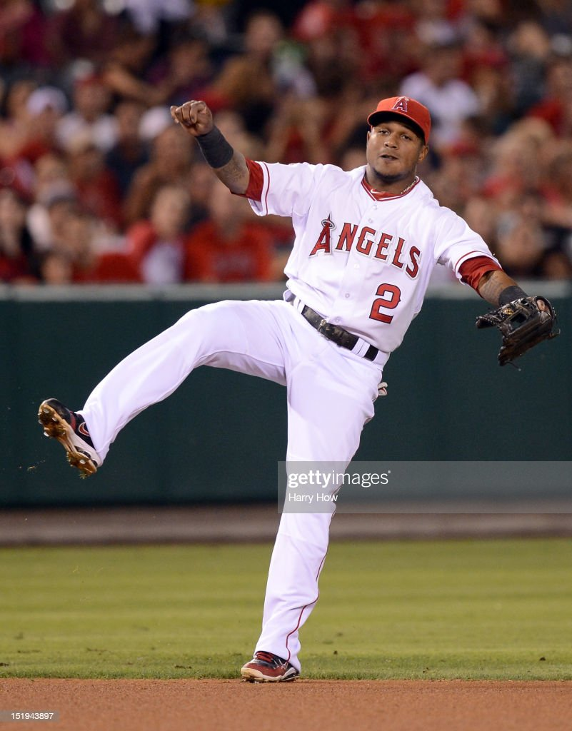 Erick Aybar #2 of the Los Angeles reacts after his throw for an out of Cliff Pennington #2 of the Oakland Athletics during the seventh inning at Angel Stadium of Anaheim on September 12, 2012 in Anaheim, California.