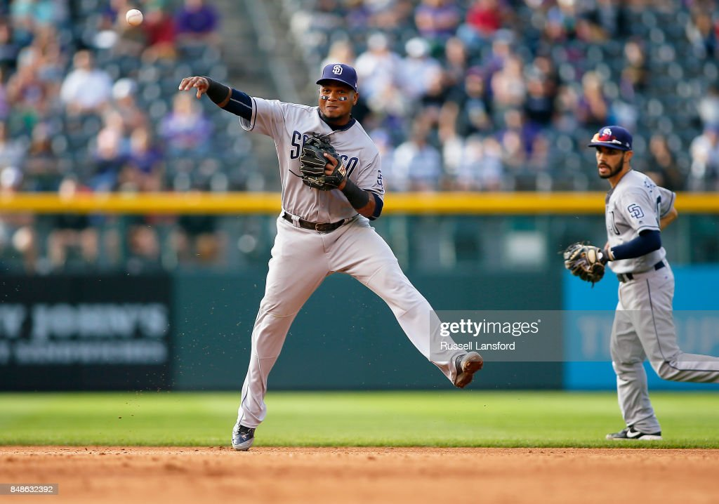 Erick Aybar #8 of the San Diego Padres makes a play on a ground ball in the eighth inning of a regular season MLB game between the Colorado Rockies and the visiting San Diego Padres at Coors Field on September 17, 2017 in Denver, Colorado.