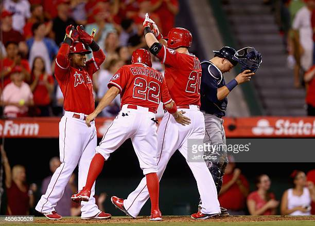 Erick Aybar Tony Campana and CJ Cron of the Los Angeles Angels of Anaheim celebrate Cron's threerun home run in the seventh inning as Seattle...