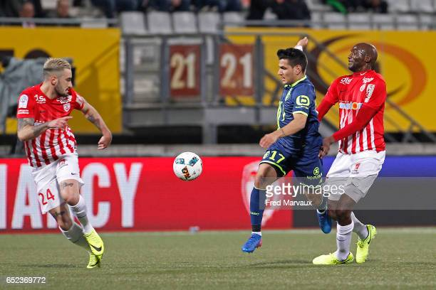 Erick Cabaco Almada of Nancy and Marcos Mesquita Rony Lopes of Lille and Alou Diarra of Nancy during the Ligue 1 match between As Nancy Lorraine and...
