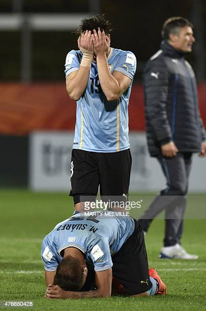 Erick Cabaco and Mathias Suarez of Uruguay sit dejected after their loss during the FIFA Under20 World Cup football round of 16 match between Brazil...