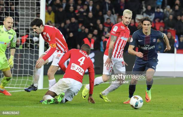 Erick Cabaco of Nancy in action with Edinson Cavani of Paris SaintGermain during the French Ligue 1 match between Paris SaintGermain and AS...