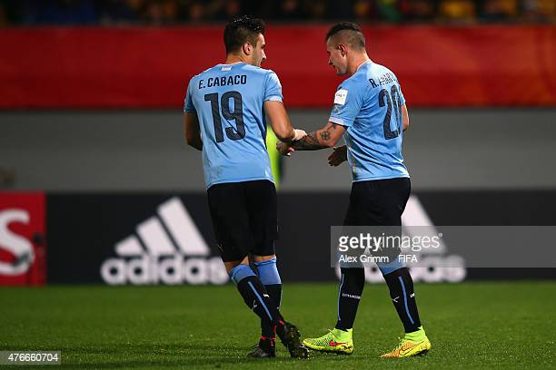 Erick Cabaco of Uruguay comforts team mate Rodrigo Amaral after he missed his penalty during the penalty shootout of the FIFA U20 World Cup New...