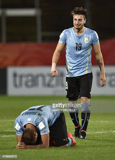 Erick Cabaco of Uruguay stands dejected with teammate Mathias Suarez after their loss during the FIFA Under20 World Cup football round of 16 match...