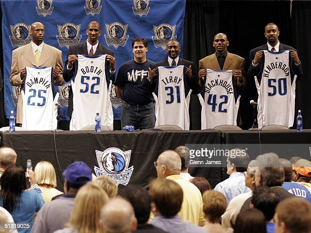 Erick Dampier Calvin Booth Mark Cuban Jason Terry Jerry Stackhouse and Alan Henderson the newest Dallas Mavericks hold up their jerseys for a photo...