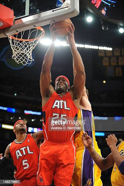 Erick Dampier of the Atlanta Hawks jumps for a rebound against the Los Angeles Lakers during the game at Staples Center on February 14 2012 in Los...