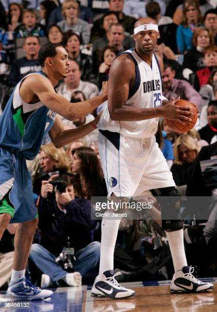 Erick Dampier of the Dallas Mavericks posts up against Ryan Hollins of the Minnesota Timberwolves during a game at the American Airlines Center on...
