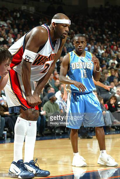 Erick Dampier of the Golden State Warriors gets set to block out Earl Boykins of the Denver Nuggets during a free throw at The Arena in Oakland on...