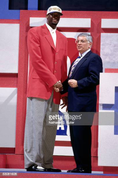 Erick Dampier poses with NBA Commissioner David Stern after being drafted by the Indiana Pacers in the first round of the 1996 NBA Draft on June...