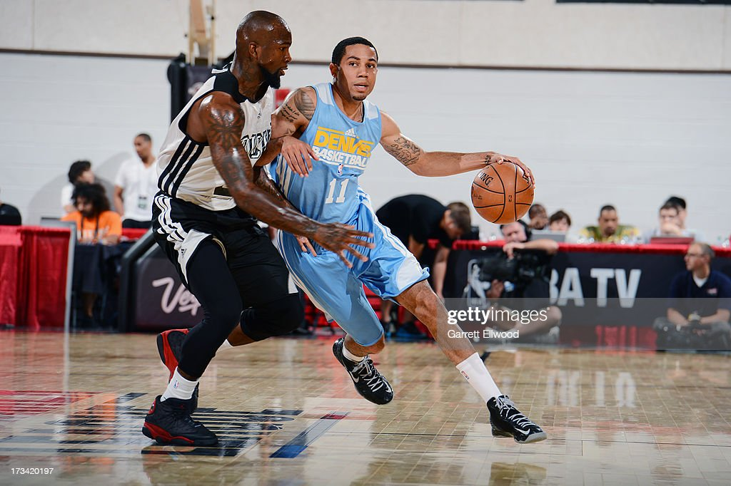 <a gi-track='captionPersonalityLinkClicked' href=/galleries/search?phrase=Erick+Green&family=editorial&specificpeople=7348606 ng-click='$event.stopPropagation()'>Erick Green</a> #11 of the Denver Nuggets drives against <a gi-track='captionPersonalityLinkClicked' href=/galleries/search?phrase=Dominique+Jones+-+Basketball+Player&family=editorial&specificpeople=4782614 ng-click='$event.stopPropagation()'>Dominique Jones</a> #20 of the Milwaukee Bucks during NBA Summer League on July 13, 2013 at the Cox Pavilion in Las Vegas, Nevada.