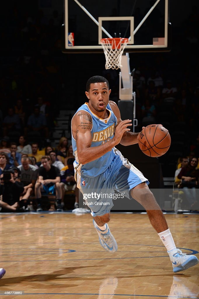 <a gi-track='captionPersonalityLinkClicked' href=/galleries/search?phrase=Erick+Green&family=editorial&specificpeople=7348606 ng-click='$event.stopPropagation()'>Erick Green</a> #11 of the Denver Nuggets drives against the Los Angeles Lakers as the Los Angeles Lakers take on the Denver Nuggets at the Valley View Sports Arena in San Diego, California on October 6, 2014 .