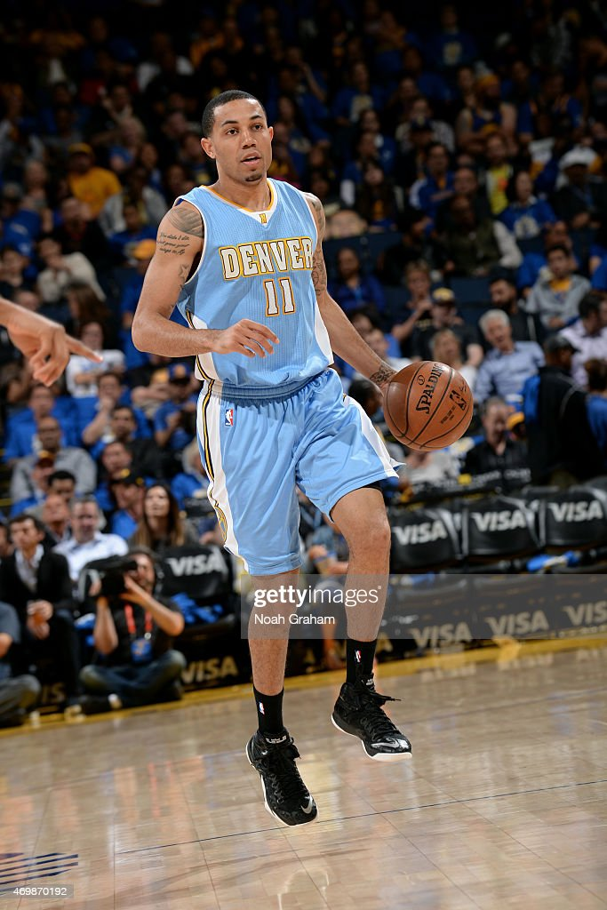 <a gi-track='captionPersonalityLinkClicked' href=/galleries/search?phrase=Erick+Green&family=editorial&specificpeople=7348606 ng-click='$event.stopPropagation()'>Erick Green</a> #11 of the Denver Nuggets handles the ball against the Golden State Warriors on April 15, 2015 at Oracle Arena in Oakland, California.