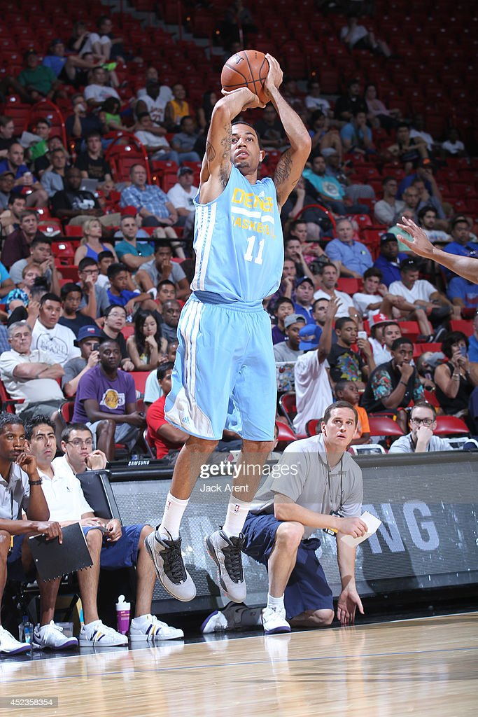 <a gi-track='captionPersonalityLinkClicked' href=/galleries/search?phrase=Erick+Green&family=editorial&specificpeople=7348606 ng-click='$event.stopPropagation()'>Erick Green</a> #11 of the Denver Nuggets shoots against the Los Angeles Lakers at the Samsung NBA Summer League 2014 on July 18, 2014 at the Thomas & Mack Center in Las Vegas, Nevada.