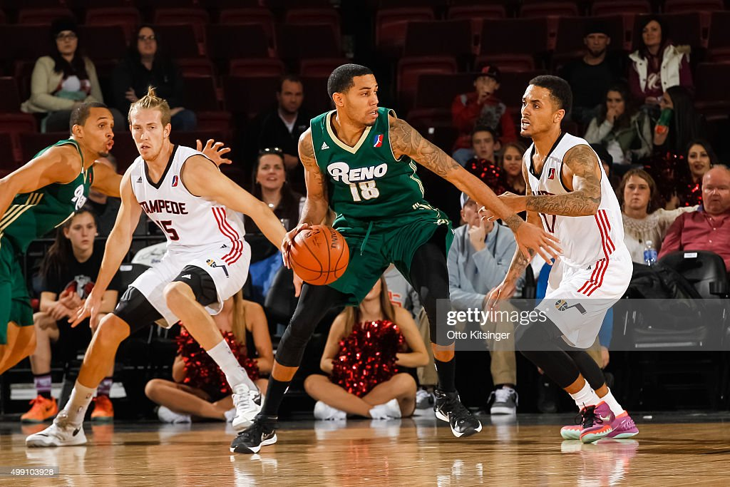 <a gi-track='captionPersonalityLinkClicked' href=/galleries/search?phrase=Erick+Green&family=editorial&specificpeople=7348606 ng-click='$event.stopPropagation()'>Erick Green</a> #18 of the Reno Bighorns defends the ball from <a gi-track='captionPersonalityLinkClicked' href=/galleries/search?phrase=Brandon+Fields+-+Basketball+Player&family=editorial&specificpeople=15211925 ng-click='$event.stopPropagation()'>Brandon Fields</a> #17 of the Idaho Stampede at CenturyLink Arena on November 28, 2015 in Boise, Idaho.