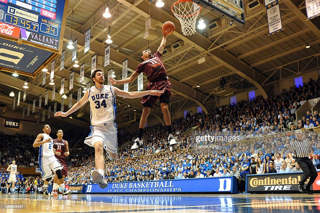 Erick Green #11 of the Virginia Tech Hokies goes to the hoop against Ryan Kelly #34 of the Duke Blue Devils at Cameron Indoor Stadium on February 25, 2012 in Durham, North Carolina. Duke defeated Virginia Tech 70-65 in OT.