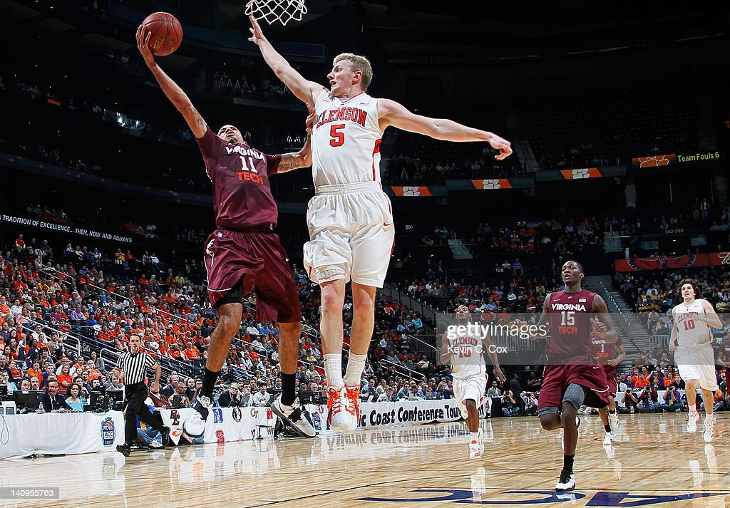 Erick Green #11 of the Virginia Tech Hokies shoots against Tanner Smith #5 of the Clemson Tigers in the second half of their first round game of 2012 ACC Men's Basketball Conferene Tournament at Philips Arena on March 8, 2012 in Atlanta, Georgia.