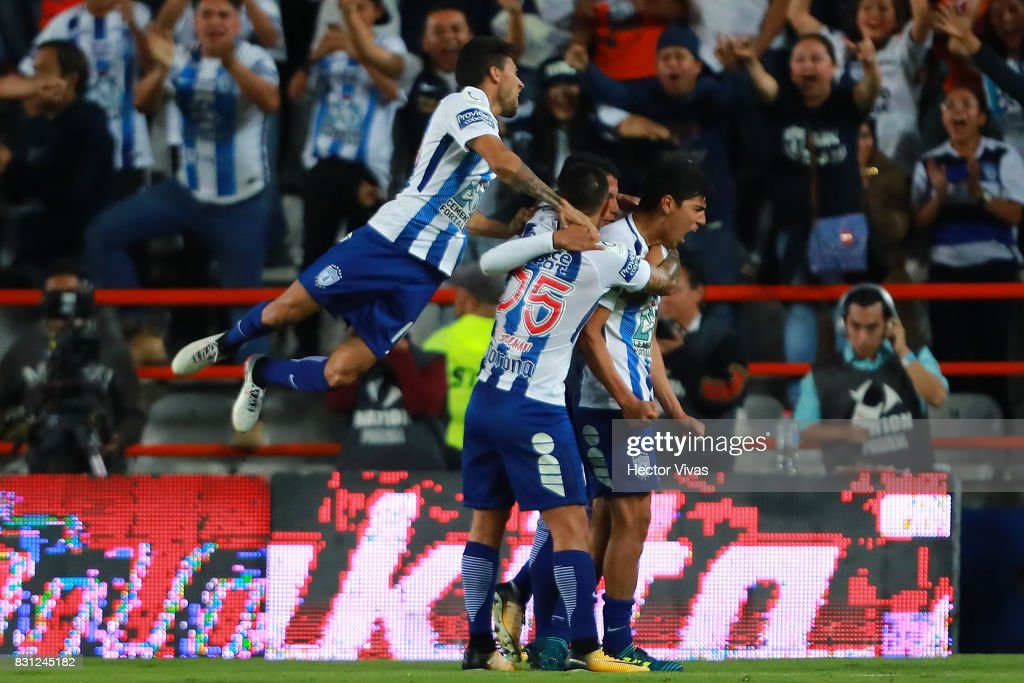 Erick Gutierrez of Pachuca celebrates with teammates after scoring the second goal of his team during the 4th round match between Pachuca and Tigres UANL as part of the Torneo Apertura 2017 Liga MX at Hidalgo Stadium on August 12, 2017 in Pachuca, Mexico.