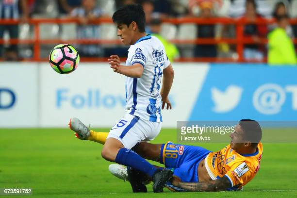 Erick Gutierrez of Pachuca struggles for the ball with Ismael Sosa of Tigres during the Final second leg match between Pachuca and Tigres UANL as...