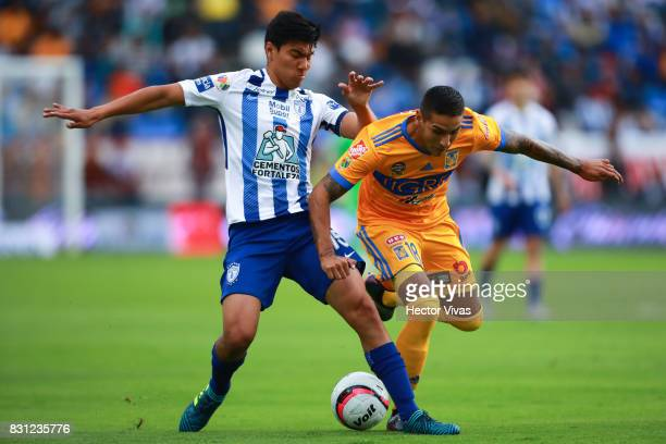 Erick Gutierrez of Pachuca struggles for the ball with Ismael Sosa of Tigres during the 4th round match between Pachuca and Tigres UANL as part of...