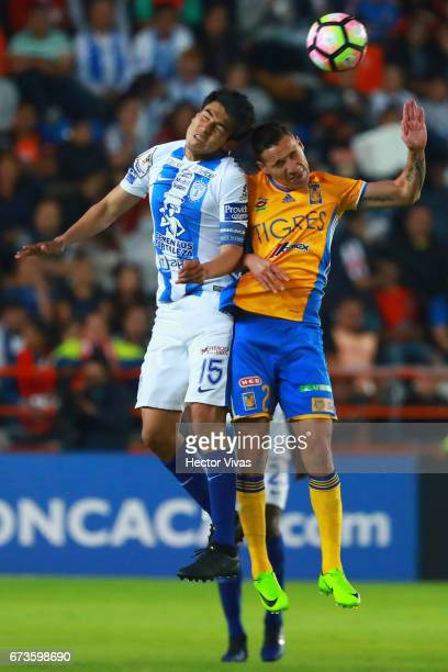 Erick Gutierrez of Pachuca struggles for the ball with Jesus Dueñas of Tigres during the Final second leg match between Pachuca and Tigres UANL as...