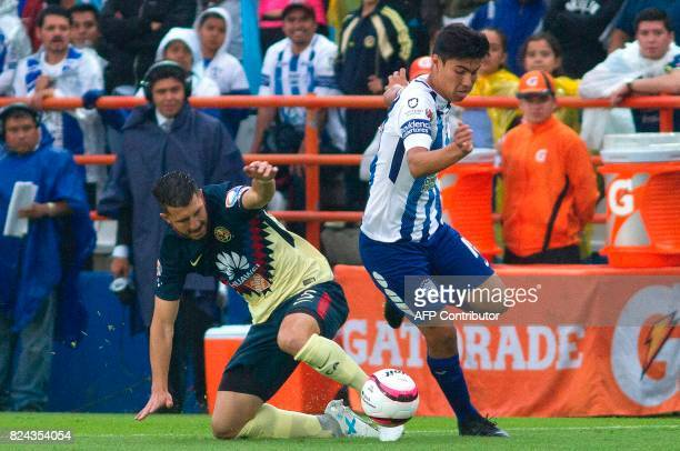 Erick Gutierrez of Pachuca vies for the ball with Guido Rodriguez of America during their Mexican Apertura 2017 Tournament football match at Hidalgo...