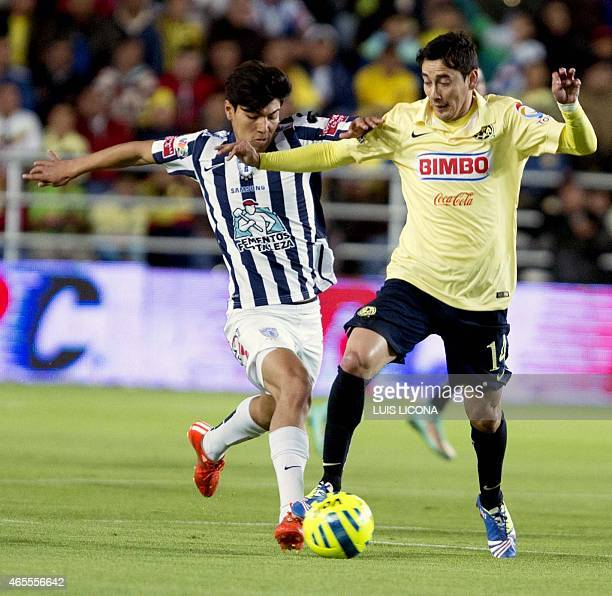 Erick Gutierrez of Pachuca vies for the ball with Rubens Sambueza of America during their Mexican Clausura tournament football match at the Hidalgo...