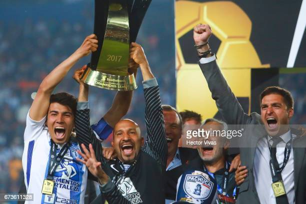 Erick Gutierrez Oscar Perez Jesus Martinez and Diego Alonso of Pachuca celebrate with the trophy after winning the Final second leg match between...