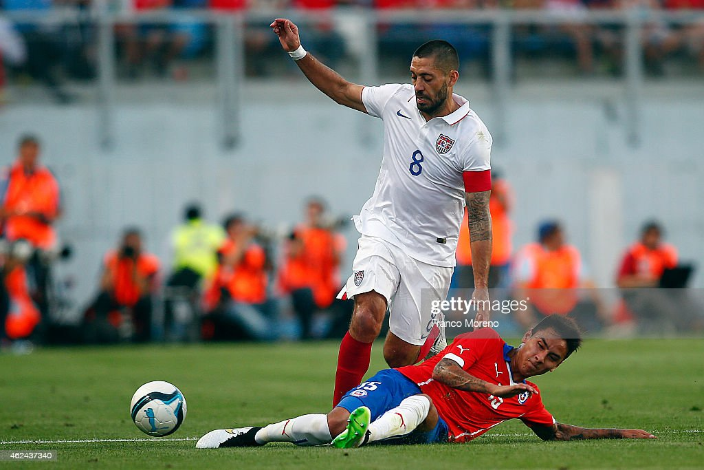 Erick Pulgar of Chile fights for the ball with Clint Dempsey of USA during an international friendly match between Chile and USA at El Teniente...
