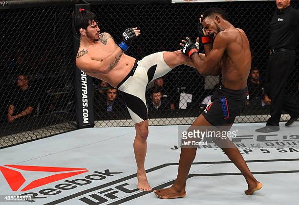 Erick Silva of Brazil kicks Neil Magny of the United States in their welterweight bout during the UFC event at the SaskTel Centre on August 23 2015...