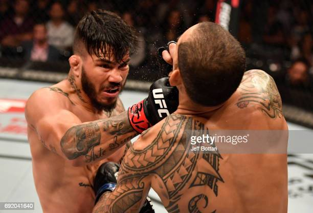 Erick Silva of Brazil punches Yancy Medeiros in their welterweight bout during the UFC 212 event at Jeunesse Arena on June 3 2017 in Rio de Janeiro...